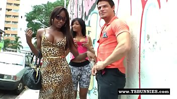 Hot big cock black tranny sucking cock in the streets